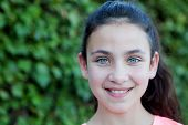 picture of  preteen girls  - Happy preteen girl with blue eyes smiling at outside - JPG