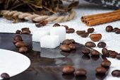 image of sugar cube  - Sugar cubes on a vinyl plate among coffee beans - JPG
