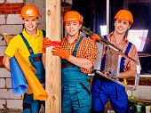 pic of millwright  - Happy group people men in builder uniform holding wooden boards  - JPG