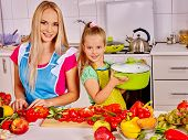 picture of pinafore  - Mother and daughter cooking vegetables food at kitchen - JPG
