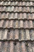 foto of roof tile  - Old roof with ceramic tiles closeup in sunny day