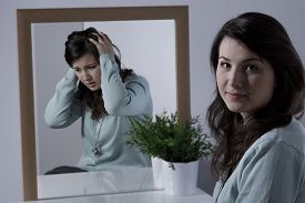 pic of emotion  - Young woman with depression hiding her emotions - JPG