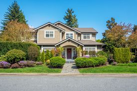 picture of in front  - Luxury house with nicely trimmed front yard lawn in a residential neighborhood - JPG