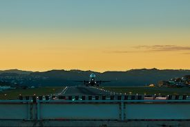 stock photo of lifting-off  - Jet plane lifting off at Wellington Airport - JPG