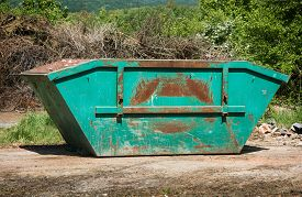 picture of dumpster  - Big dumpster trash in the landfill - JPG