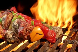 picture of charcoal  - Mixed Meat And Vegetables Kebabs On Flaming Charcoal Barbeque Grill Background - JPG