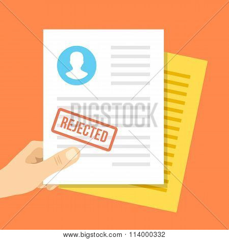 Job application rejected. Hand holds job application with rejection stamp on it