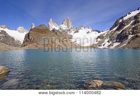 Majestic Peaks Above An Alpine Lake