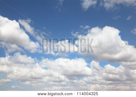 White light cumulus clouds in a high blue sky