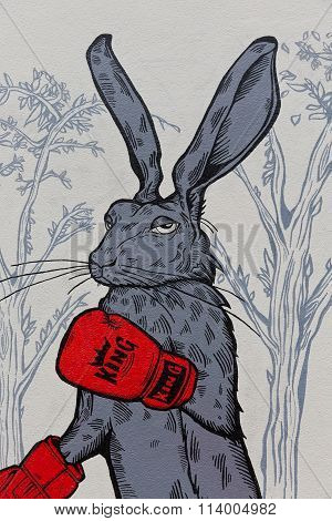 April 2014 - Bristol, United Kingdom: A Graffiti Of A Grey Boxing Rabbit With Red Boxing Gloves