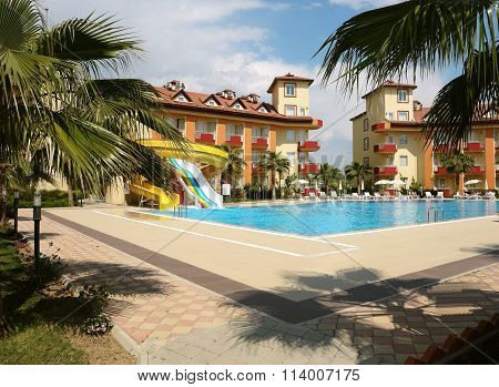 Swimming Pool And Buildings Of Hotel.