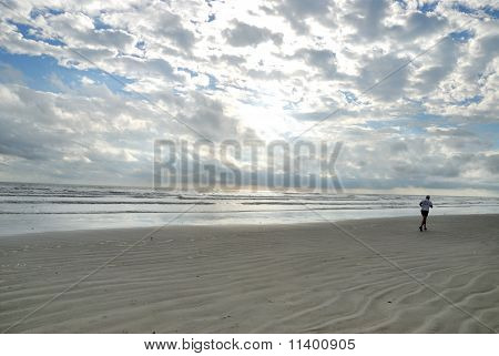 early morning jogger on the beach