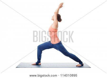 Beautiful sporty fit yogini woman practices yoga asana Virabhadrasana 1 - warrior pose 1 isolated on white
