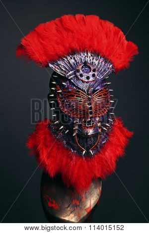 Steel mask with spikes and red feathers