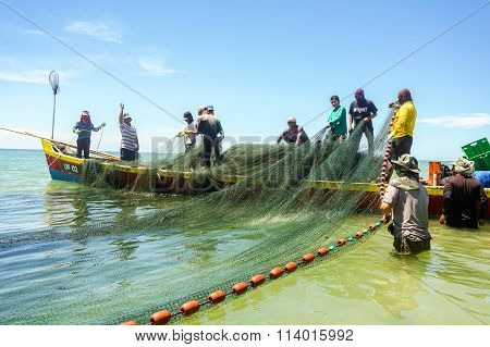 LABUAN FT, MALAYSIA - Aug 29, 2015.Fishermans on the boat with net at Pohon Batu beach, Labuan.