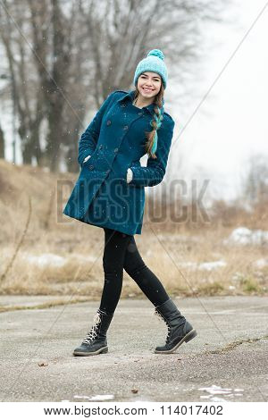 Winter fashion girl in coat and beanie