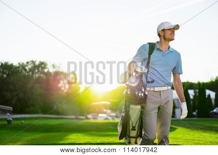 Young man with a stick outdoors