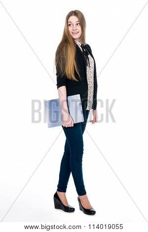 Full Length Of Young Blond Smiling Girl Holding Clipboard Surprise Looking Back
