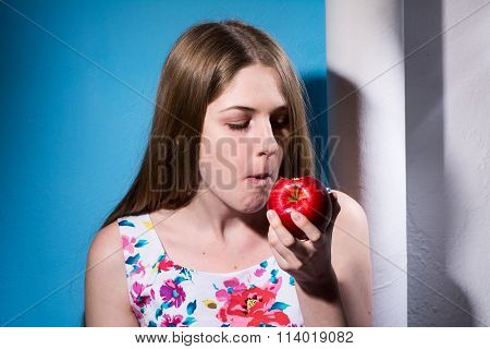Close-up Of A Girl Eating A Red Apple