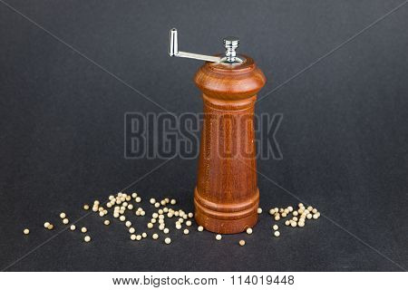 Wooden Pepper Crusher On Black Background
