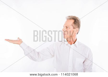 A Man In White Shirt Stares With Put Out Hand