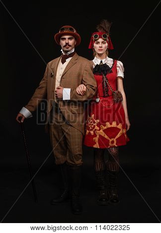 The Couple Steampunk. A Man With A Cane And A Girl With Glasses