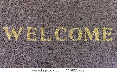 Welcome Text On Brown Doormat