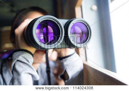 Woman looking though binocular
