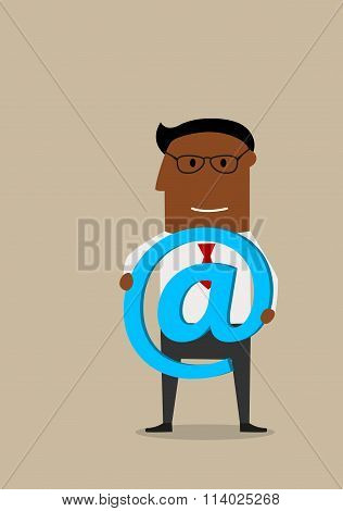 Businessman with e-mail technology symbol in hands