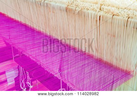 Weaving Loom And Shuttle On The Warp