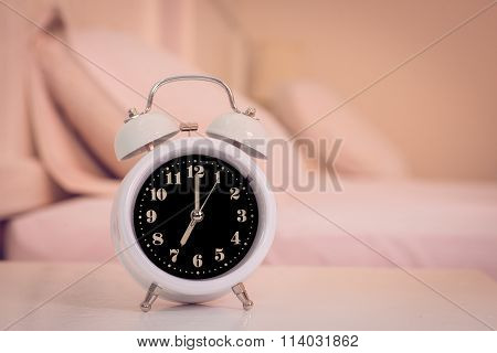 Alarm Clock On The Bed In Bedroom, Retro Style
