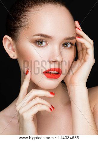 Beautiful Woman Face Closeup Over Black Background. Beautiful Perfect Lips.