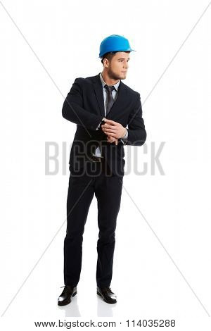 Businessman checking time on his wrist watch.