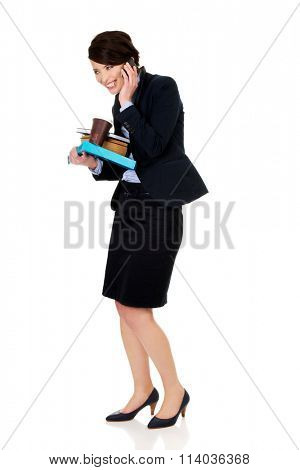 Hurry businesswoman talking on the phone.