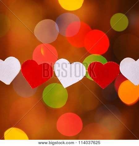 Garland With Red And White Hearts  On Boke Background
