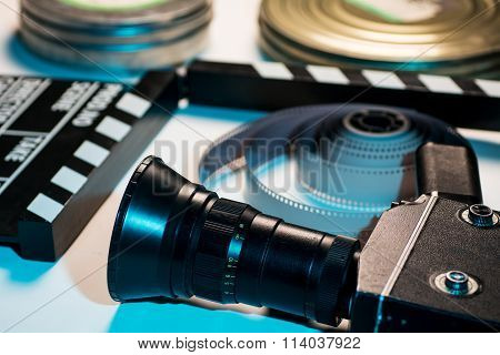 Old Retro Camera, Film Clapper, Rolls Of Film And A 35Mm Box Films