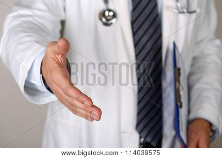 Male Medicine Doctor Offering Hand To Shake Closeup