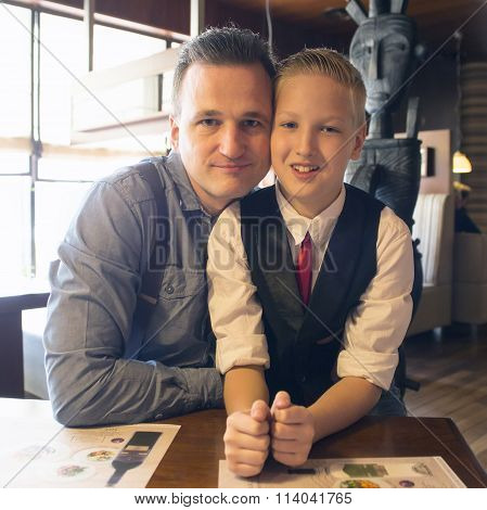 Father And His Son In Cafe Or Restaurant.