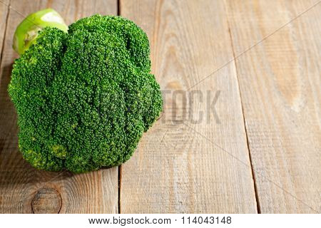 Raw fresh broccoli on wooden background