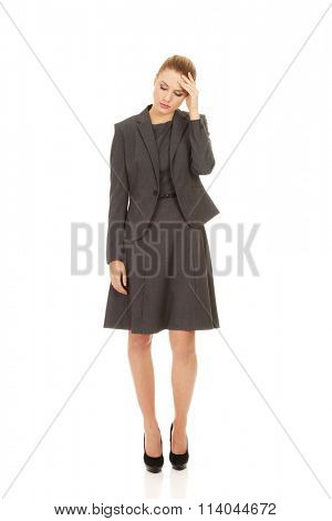 Businesswoman with head ache.