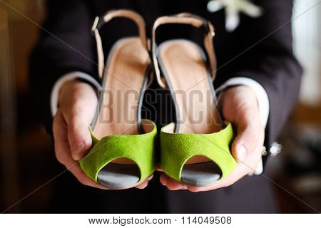 Bridesmaid's s Shoes Green In The Hands Of Groom