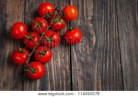 Fresh cherry tomatoes on wood background. Top view