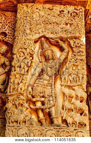 Artistic sculptures Lord Krishna on the walls of Hoysaleswara temple at Halebidu, Karnataka