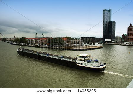 City Of Rotterdam Uptown Skyline By The River In South Holland With Large Boat, The Netherlands.