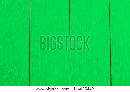 Green boards, a wooden background