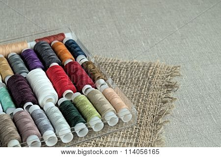 Spools of colored sewing thread.