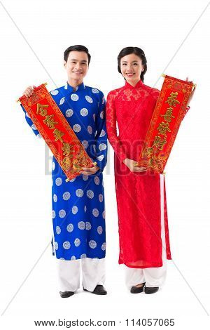 Couple with New Year scrolls