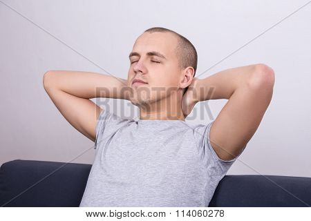 Young Man Napping On Sofa At Home