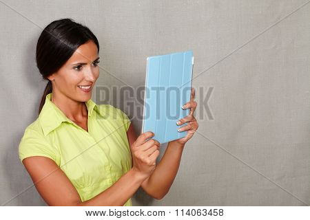Charismatic Lady Holding And Looking At Tablet