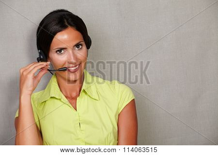 Toothy Smiling Receptionist Talking On Headset